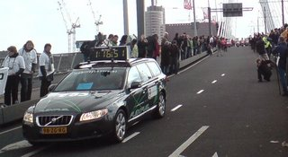 The advance car showing the time and motorcycle escort